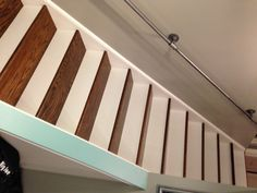 hardwood-stairs-metal-railing-to-finished-basement