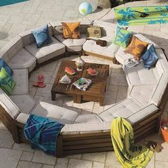 I looooove this. Maybe with a fire pit instead. Or a fire pit that you can find a flat cover to go over it to turn it into a table!