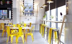 Superette, Cape Town. Such a shiny happy place! Love the yellow & silver tolix bar stools/chairs.