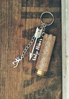 Rose gold glittered is sealed to keep the glitter shedding to a very minimum. Happy to customize any order just shoot me a message. Dont like rose gold? Check out the listing for this keychain in Teal or pink! https://www.etsy.com/listing/238533805/teal-turquoise-glittered-12-gauge