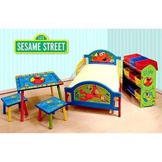 Sesame Street Elmo Room in a Box Toddler Bed Table Storage Set - Bed made with sturdy steel and PVC. Bed frame comes with center legs for extra support. Can hold a standard crib/toddler mattress of x inches x cm). Suitable for kids up to