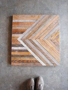 Salvaged flooring made into tables by Ariele Alasko