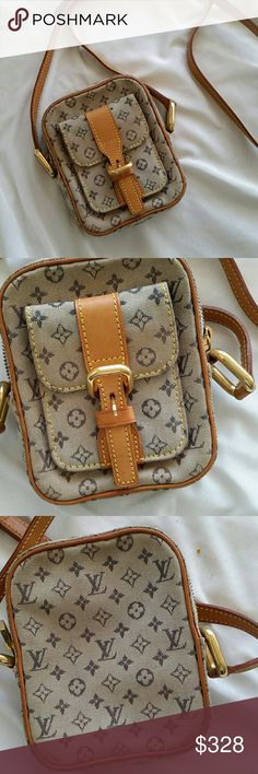 RARE LV JULIE LV messenger bag with long strap to crossbody. Great condition, monogram canvas intact, inside clean no defects. I cannot open the inside pocket wide enough to get a picture of the date code which is TH0040. The fabric is grayish beige and lettering is dark gray Leather in great condition, some tarnish on metal parts. One little outside pocket and one inside. Little lock detail on zipper pull. If you have questions or want more pics please ask. Louis Vuitton Bags Crossbody Bags