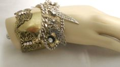 Beautiful Gold Tone Cuff.  Flowers and Butterflies.  Silver and Gold Tone.