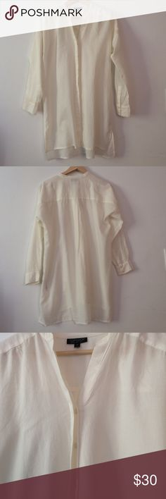 TOPSHOP white tunic shirt This shirt tunic is perfect for jeans casual or office casual. The color is off-white (between white and ivory). Cotton 100%. Worn a few times. Very good condition. Length from top shoulder to bottom hem: front 29.5 inches, back 31.5 inches. Sorry, no trade! Topshop Tops Tunics