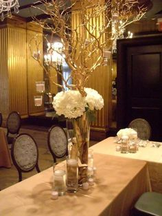 Centerpieces with pink/white hydrangeas on round tables with crystals and hanging votives   Garden on the Square