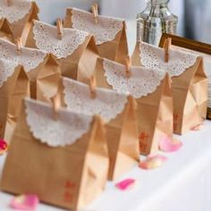 I just love a quick and easy party favor idea, like these sweet paper bags trimmed with doilies! They're from a wedding featured on Style Me Pretty. To add a little personalization, there's a red stamp in the lower right-hand corner of each bag, and . Garden Party Favors, Garden Party Wedding, Diy Wedding Favors, Party Favor Bags, Shabby Chic Office, Shabby Chic Baby Shower, Decoration, Paper Bags, Ideas Party