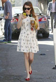 Emma Roberts wearing Salvatore Ferragamo Varina Flats and Christian Louboutin Sweet Charity Sotto Pelle Pouchette in Canari.