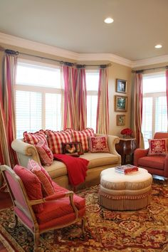 plaids, stripes and dots combined with more sophisticated rug designs on simple furniture.  Not cutesy but cozy and elegant.