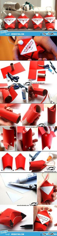 süße kleine #Weihnachtsmänner #basteln: Die #Anleitung zeigt, wie man die Figuren aus rotem Buntpapier machen kann.