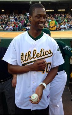 #GSWarriors forward Harrison Barnes throwing out 1st pitch at #athletics game tonight.