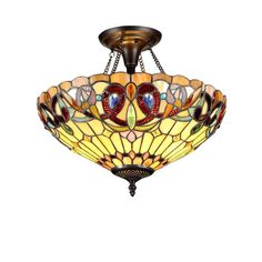This beautiful Victorian-design 2-light flush mount features a Tiffany-style shade of beautiful beige, amber and green art glass. Complete with a bronze finish, lend an artistic, colorful accent to your home with this beautiful light fixture.