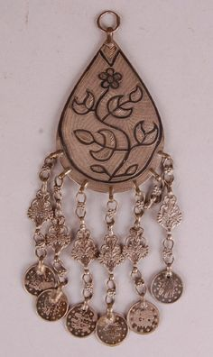 Silver and niello amulet pendant made by Armenian silversmiths living in Jordan.  Worn in Jordan and Palestine.
