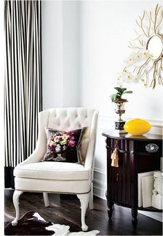 Adore so much about this. The yellow pop, the branched mirror but especially, I LOVE those black and white pinstriped curtains.