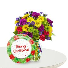 Flowers of Christmas  Price:  US$55.99  An exceptional piece of gift this is. Colorful flower vase with a Christmas wishes balloon is something beyond their imagination of gift they receive on this Christmas. Spread the fun of joy in air with air-filled balloon and outstanding collection of lovely flowers.