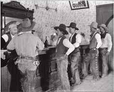 "COWBOYS of the old LS ranch - ""settling the dust"" ... drinking at the Equity Bar in Old Tascosa, 1907.  Tascosa was called the cowboy capital of the Texas Panhandle and the hardest place on the frontier.  As well as being the center of ranching activity in the Panhandle, Tascosa became the last best hiding place in Texas for killers on the run, horse thieves, tinhorn gamblers, hair-trigger shootists or anyone else with a past he wanted to get away from."