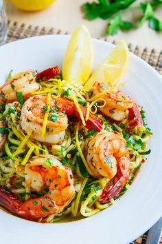 Shrimp Scampi with Zucchini Noodles Recipe : Shrimp served in a lemony, garlicky and buttery sauce over a bed of light and fresh zucchini noodles, aka zoodles; a lighter take on shrimp scampi. Zucchini Noodle Recipes, Zoodle Recipes, Spiralizer Recipes, Seafood Recipes, Pasta Recipes, Cooking Recipes, Dinner Recipes, Healthy Recipes, Freezer Recipes