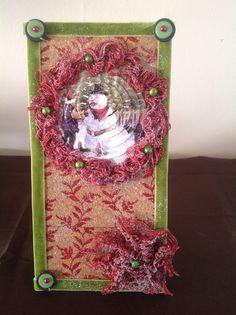 Een kerst kaart met kurk,lint, 3D etc gemaakt
