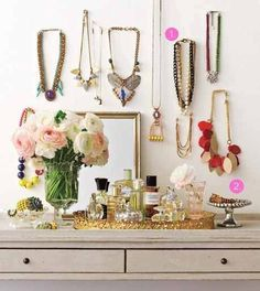 Why don't you organize and display your jewelry so you can always see your options? Notice the small dishes filled with bracelets - another great idea! via Apartment Therapy belle maison: Organization Necklace Storage, Jewellery Storage, Jewelry Organization, Organization Hacks, Necklace Display, Vanity Organization, Organizing Solutions, Necklace Holder, Jewellery Displays