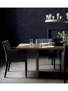 the origami drop leaf dining table unfolds its updated look in black metal and beautifully grained acacia wood bleached and stained light walnut