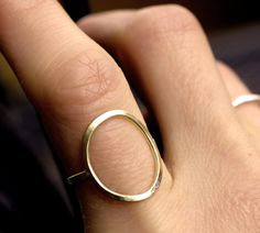 gold circle ring modern minimalist organic satin brass simple cocktail ring brushed brass wire big circle large gold ring CIRCLE RING. $35.00, via Etsy.