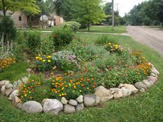 Use of the stone is important to make this border garden unique.