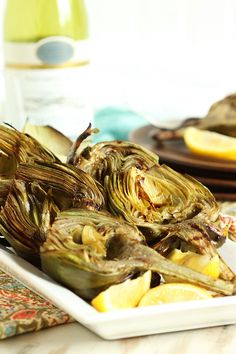 Healthy and easy, grilled artichokes are an excellent summer starter or side dish.  The Garlic Asiago Dipping Sauce is perfect served alongside. @thesuburbansoapbox