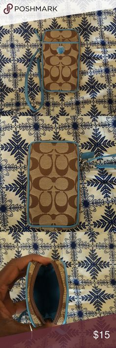 Coach Phone Case Wristlet Tan and brown canvas Coach wristlet with monogram all around. Sky Blue accents (snap and leather wrist strap). Slip pocket on the front. Zipper opens to one main compartment. Perfect for phone and other small items. Accessories Phone Cases
