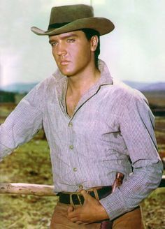 """""""Flaming Star,"""" a 1960 Western film starring Elvis Presley and Barbara Eden, based on the book Flaming Lance (1958) by Clair Huffaker. Critics agreed that Presley gave one of his best acting performances as the mixed-blood """"Pacer Burton"""", a dramatic role. The film was directed by Don Siegel and had a working title of Black Star. The movie reached No. 12 on the box office charts."""