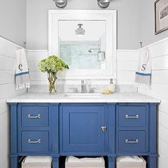 I love a small space with lots of style like this little bathroom.  There's even plenty of  smart storage!