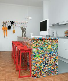 I wouldn't ever do this but how cool would Lego furniture be for a little boy's room! A kitchen island made of Legos! Plus more (usually smaller) Lego decor ideas -- via homejelly.
