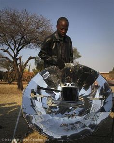 A solar cooker being used at the Jericho community center during the World Cup final match viewing. The Jericho project, a solar powered public viewing area for the World Cup, was initiated by Greenpeace Africa, marrying entertainment with education and proving how solar power has to be the solution for South Africa's energy crisis.