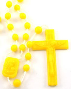 Yellow Plastic Rosaries. Unlike other plastic rosaries on the market, ours are made with the latest technology out of high quality nylon, including the string. From that perspective they should not crack or break. (As child safe as can be). We've sold millions of these rosaries and have never had a complaint.