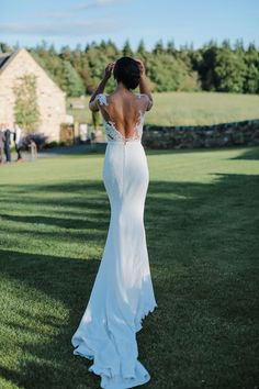 Bride wears a backless Pronovias Gown for a Glamorous and Sophisticated Barn Wedding. Images by Helen Russell Photography