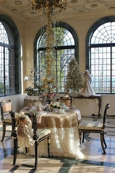 Love the gorgeous windows....the ceiling....the ruffled table cover.....