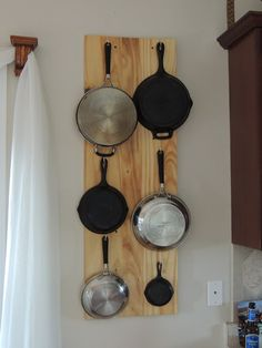 DIY - A great way to hang your nice pans to clear up room in your kitchen cabinets - via Leave a Happy Plate