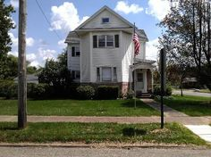 3 Story home on corner lots. 4 bedroom, 1 1/2 bath. Third story could be another bedroom. Full basement. Garage. Great curb appeal. $129,000 New price!