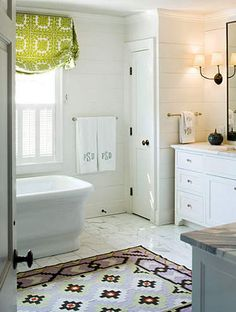 gorgeous rug in a spacious white bathroom
