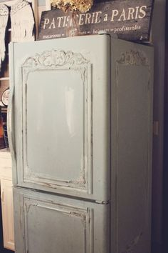 Chalk paint fridge!  Just add some pretty molding and you've turned an ugly appliance into a vintage-y beauty!