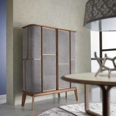 Solid walnut wood makes the structure of this cabinet that is a functional piece of design. The slanted legs evoke the charm of mid-century furniture, while. Bar Furniture For Sale, Design Furniture, Luxury Furniture, Modern Furniture, Furniture Ideas, Italian Furniture, Outdoor Furniture, Living Room Cabinets, Living Room Furniture