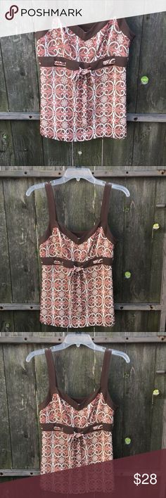 Dressy Top by Ann Taylor Loft SZ 6 This lovely summer camisole dressy too by Ann Taylor Loft is so soft and romantic with muted shades of dusty rose pink, brown and cream. It is sheer with a cream lining and has a draw string type tie at the waist with a side zipper. Ann Taylor Loft Tops Camisoles