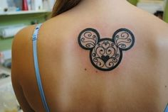 A classy mickey mouse tattoo with hearts hidden inside.