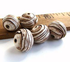 Handmade Polymer Clay Round Beads - Weird Pods. $12.00, via Etsy. Beadsbyearthtones