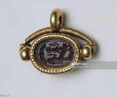 Phoenician civilization, century b. Carnelian scarab with Isis and Horus as a child, set in gold. Get premium, high resolution news photos at Getty Images Bronze Age Civilization, Purple Dye, Phoenician, Ancient Art, Carnelian, Ceramic Pottery, Archaeology, Metal Working, Antique Jewelry