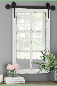 What a unique twist on an old farmhouse window favorite.  A mirrored window on barn like rails. I would love this in my home.  Rustic Antique White Farmhouse Mirror.  18.25L x 1.25W x 32.75H in #ad #homedecor #walldecor #farmhouse