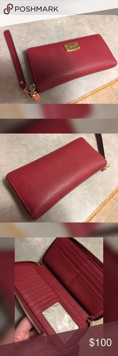 """💥MICHAEL KORS JET SET CONTINENTAL WRISTLET💥 LIKE NEW MICHAEL KORS JET SET TRAVEL CONTINENTAL LEATHER WRISTLET. COLOR IS """"CHERRY"""". USED FOR MAYBE ONE WEEK!!! NO DAMAGE AT ALL!!  8.25 x 4 x 0.75. WRISTLET STRAP IS DETACHABLE. GOLD HARDWARE. Michael Kors Bags Wallets"""