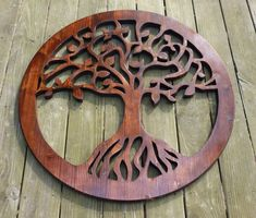 The concept of a tree of life has been used in science, religion, philosophy, and mythology. It alludes to the interconnection of all life on our p. Carved Wood Wall Art, Wooden Wall Decor, Tree Wall Decor, Wood Art, Scroll Saw Patterns Free, Scroll Pattern, Modern Small House Design, Meditation Art, Celtic Tree Of Life