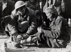 Once the battle was won in the desert, German and Italian troops surrendered readily without further resistance. This is one of many photographs taken of Allied troops aiding the captured soldiers who, perhaps only a day before, had been trying to kill them.