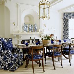 35 reasons why I love decorating with blue and white - The Enchanted Home -- good mix of patterns - like the addition of blue glasses to table