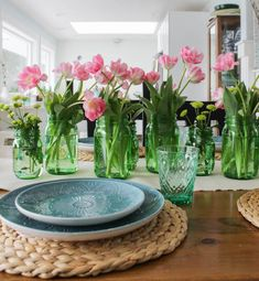 cute tulips with green mason jar / from The Happy Housie